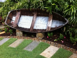 timber boat used as garden seat