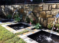 Water feature in feature stone wall