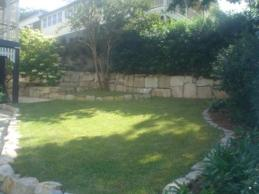 Turf and sandstone walls