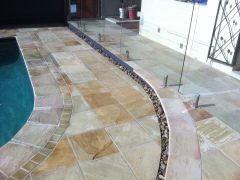 Sandstone pool Surrounds with pebble strip drain