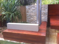 Kwila bench seat/ Stackstone Cladding back wall