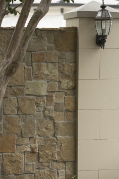 Clancy stone cladding with render pillar