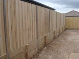 Sleeper retaining with standard treated pine fence