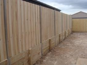 Sleeper retaining with standard treated pine fence