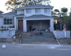 front brick retaining concrete drivewayb