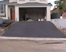 front brick retaining concrete drivewayd